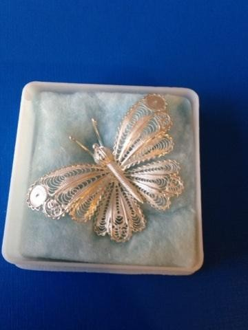 Silver filigree butterfly brooch.