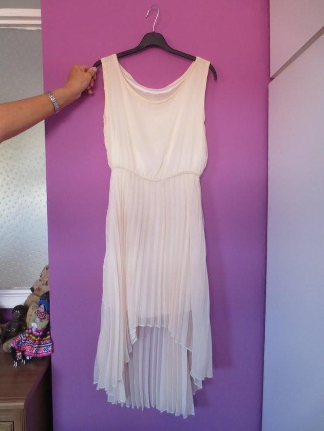 Brand New. Never been worn. Beautiful sheer dress