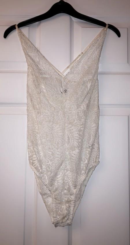 U.K. size 12 white lace pretty little thing bodysuit